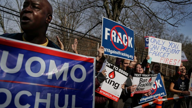 Supporters for New York Gov. Andrew Cuomo and anti-fracking demonstrators shout slogans outside the polling site as the governor left the grounds Nov. 4 in Mount Kisco.