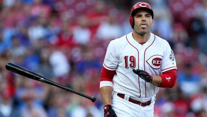 Cincinnati Reds first baseman Joey Votto (19) reacts after being hit by a pitch in the first inning during a National League baseball game between the New York Mets and the Cincinnati Reds, Tuesday, May 8, 2018, at Great American Ball Park in Cincinnati.