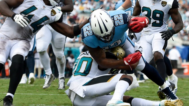 Tennessee Titans running back Derrick Henry (22) dives in for a 17-yard touchdown run in the third quarter against the Jaguars at EverBank Field Sunday, Sept. 17, 2017 in Jacksonville, Fla.