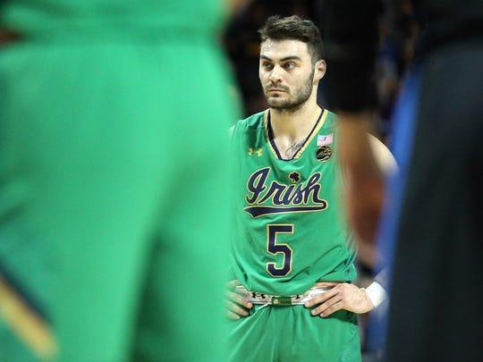 Notre Dame Fighting Irish guard Matt Farrell (5) reacts