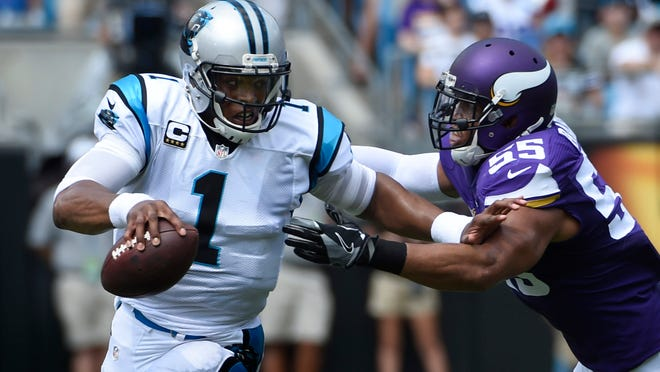 Sep 25, 2016; Charlotte, NC, USA;  Carolina Panthers quarterback Cam Newton (1) with the ball as Minnesota Vikings outside linebacker Anthony Barr (55) defends in the first quarter at Bank of America Stadium. Mandatory Credit: Bob Donnan-USA TODAY Sports ORG XMIT: USATSI-268292 ORIG FILE ID:  20160925_bsd_sd2_352.JPG