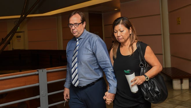 In this July 28 file photo, University of Guam professor Michael Ehlert with his wife Eva Lin at the Superior Court of Guam.