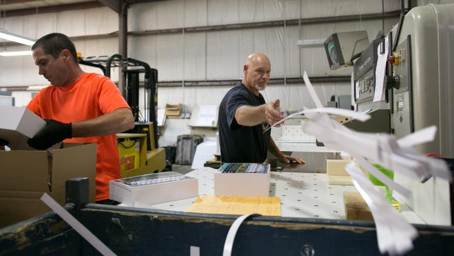 Spencer Kuhls of Holley, right, and Chris Zimmer of Henrietta work at Conolly Printing in Gates on Wednesday, June 17, 2015.