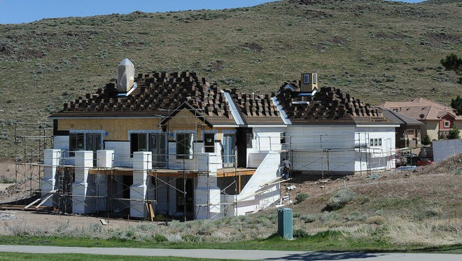 A high-end house is under construction on the golf course at Red Hawk in Wingfield Springs, April 15, 2016.