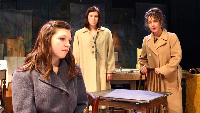 "Anne Frank (Elizabeth Fisher) shares a moment with her sister Margot (Katy Merriman) and mother, Edith (Jami Bassman), in ""The Diary of Anne Frank,"" which Repertory Theater of Iowa presents through April 26 at the Des Moines Social Club."
