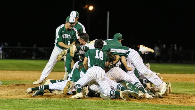 The Delbarton baseball team celebrates its 6-5 extra-inning defeat of Randolph in the Morris County Tournament final.