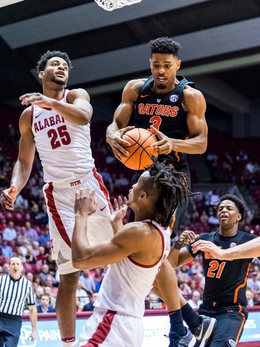 Florida guard Jalen Hudson (3) rebounds as Alabama forward Braxton Key (25) contests it during the first half of an NCAA college basketball game, Tuesday, Feb. 27, 2018, at Coleman Coliseum in Tuscaloosa, Ala. (Vasha Hunt/AL.com via AP)