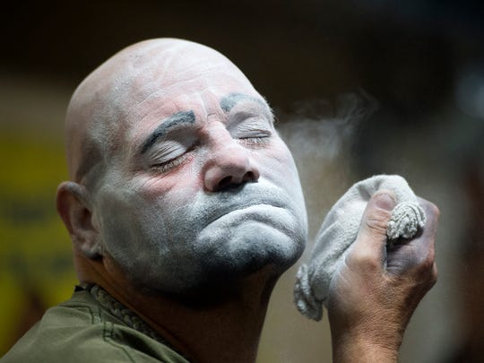 "Brian ""Ranger Joe"" Bullock, the Hadi Shrine Funsters' newest member, applies powder to set his ""Hobo"" style of clown makeup at the Funster barn in Evansville, Ind., on Monday, Nov. 13, 2017. Bullock was taught to apply his own makeup for the first time that evening."