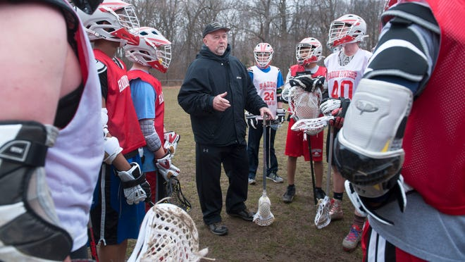 Haddon Township boys' lacrosse coach Ed McLaughlin instructs his players during practice.