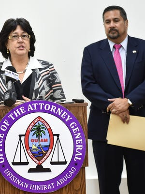"Attorney General Elizabeth Barrett-Anderson, left, delegates Chief Prosecutor Philip Tydingco, right, to procure an independent prosecutor to investigate illegal Adelup pay raises in Tamuning on Feb. 11, 2016. In his address, Tydingco stated, ""The final contract must be executed by the governor, under Guam law."""