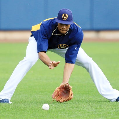 Keon Broxton fields a ground ball during spring training