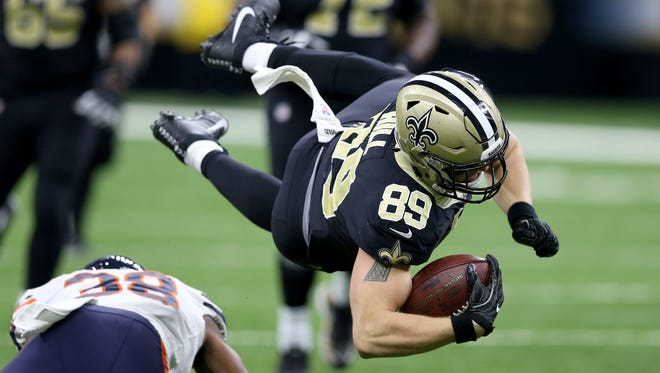New Orleans Saints tight end Josh Hill flies after a tackle by Chicago Bears strong safety Adrian Amos during the second half at the Mercedes-Benz Superdome.