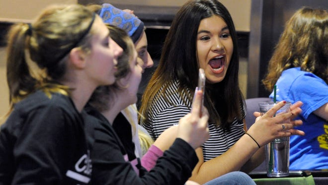 Elizabeth Oxley, a freshman at Abilene Christian University, lipsynchs along to Lady Gaga's Superbowl halftime show Sunday evening Feb. 5, 2017. Students gathered at the ACU Student Center to watch the game, dining on pizza and soda.
