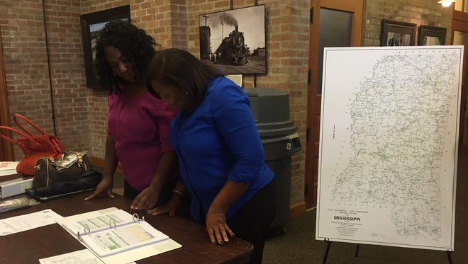 Deshella Butler, left, and Tonette Dale look over MDOT's Statewide Transportation Improvement Program on Tuesday at the historic Train Depot in downtown Hattiesburg.