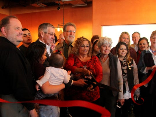 Lucy Yanez, center, celebrated the grand opening of her newest restaurant with members of the community at the Cascades on Thursday.
