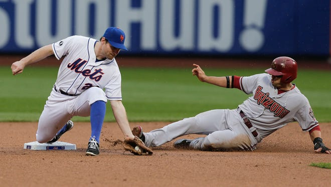The Mets' Daniel Murphy takes the throw and forces out Arizona's Martin Prado in the sixth inning Saturday night at Citi Field during the Mets' 3-2 loss.