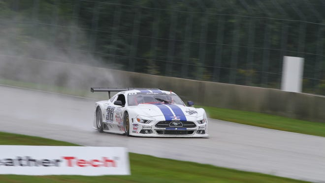 Cliff Ebben circles Road America in the rain on his way to victory in the Trans Am race Saturday, August 27, 2016 in Elkhart Lake, Wis.