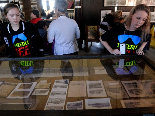 "Destiny Hall (left) and Cadence Smith, both 12, look at photographs in a glass case at the Roaring Ranger Oil Boom Museum Wednesday, Oct. 18, 2017. ""It was cool to see what our town looked like before,"" Cadence said. The city celebrated the 100th anniversary of its oil boom the day before."