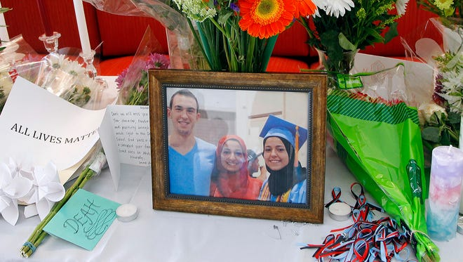 A makeshift memorial appears on display, Wednesday, Feb. 11, 2015, at the University of North Carolina School of Dentistry in Chapel Hill, N.C., in remembrance of Deah Shaddy Barakat, 23, Yusor Mohammad, 21, and Razan Mohammad Abu-Salha, 19, who were killed on Tuesday.