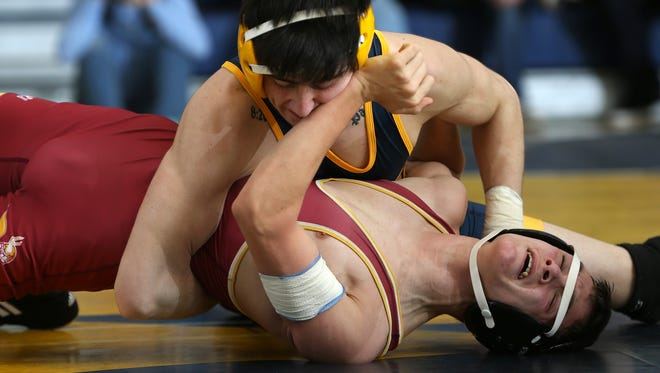 Vito Intili of Delaware Valley wrestles Josh Csayni of Voorhees in the 120lb match, Wednesday, January 20, 2016, in Alexandria.