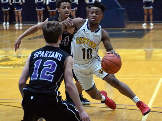 Central's Josh Mann (10) drives the court during game
