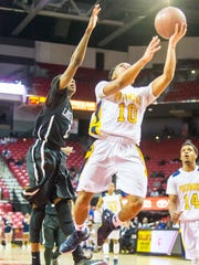 Pocomoke point guard Tyler Nixon (10) takes a shot against Lake Clifton in the MPSSAA 1A Finals at the Xfinity Center in College Park on Satuday, March 12.
