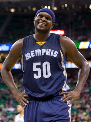 Memphis Grizzlies forward Zach Randolph (50) talks with a fan during a break in the action during the second half against the Utah Jazz at EnergySolutions Arena.