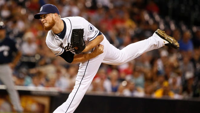 FILE - In this Oct. 1, 2015, file photo, San Diego Padres closer Craig Kimbrel follows through with a pitch against the Milwaukee Brewers in the ninth inning of a baseball game in San Diego.