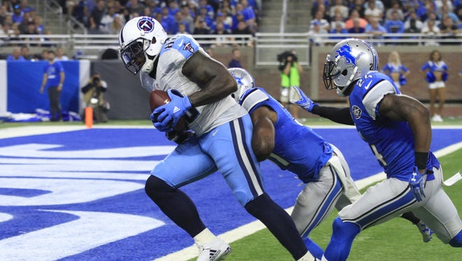 Titans tight end Delanie Walker outruns Lions cornerback Nevin Lawson (24) to the end zone for a touchdown during the second half Sunday.