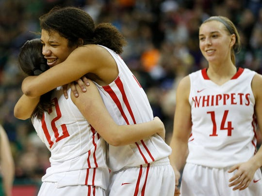 Whitewater's Myriama Smith-Traore, center, hugs Kate Riemer, left, as Rebekah Schumacher looks on after they defeated Kettle Moraine Lutheran 47-30 in the Division 3 semifinals.