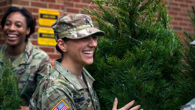 Members of the military pick out Christmas trees Wednesday in Bordentown.