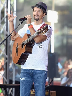 Singer-songwriter Jason Mraz performed an acoustic set with percussionist Toca Rivera at the Riverside Theater.