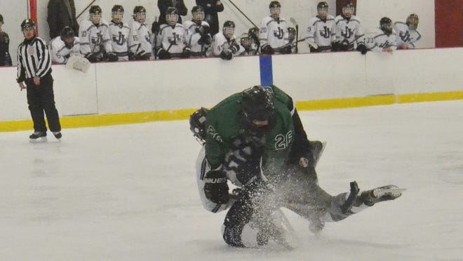 John Jay defenseman Charlie Hastings (bottom) takes Yorktown forward Liam Donnelly off the puck in the slot. The Huskers scored five unanswered goals to win 5-1 on Sunday at Brewster Ice Arena. Donnelly finished with a goal and two assists to reach 100 career points.
