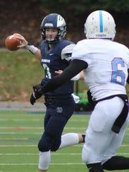 Cranbrook Kingswood quarterback Trevor McConnell (3)