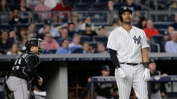 New York Yankees' Aaron Hicks reacts after striking out against the Colorado Rockies to end the sixth inning of a baseball game Tuesday, June 21, 2016, in New York.