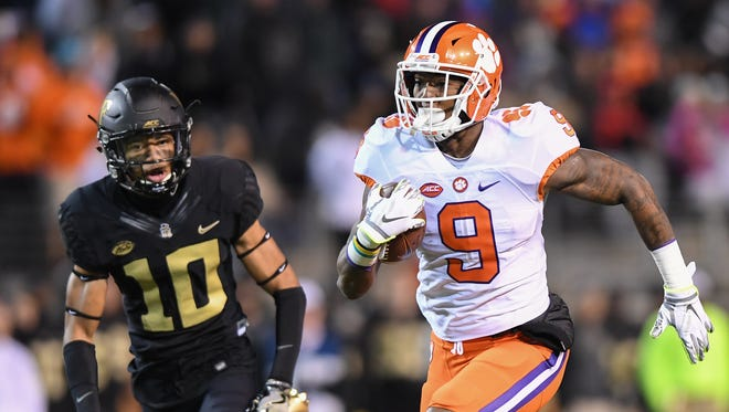 Clemson running back Wayne Gallman (9) races 41 yards to score a TD against Wake Forest during the 1st quarter at Wake Forest's BB&T field on Saturday, November 19, 2016 at