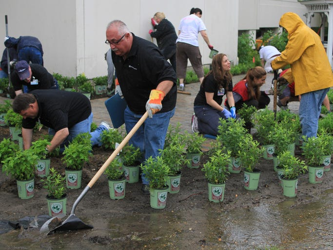 ASB 0610 Hospital Garden TOMS RIVER, NJ - Community Medical Center in Toms River, gets help from staffers, Lowe's employees, American Littoral Society and others, in building a storm water basin on the hospital grounds, Monday, June 9, 2014.
