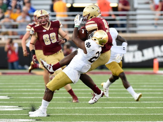 Boston College Eagles wide receiver Kobay White (9) and Notre Dame Fighting Irish cornerback Shaun Crawford (20) battle for the ball during the second half at Alumni Stadium.
