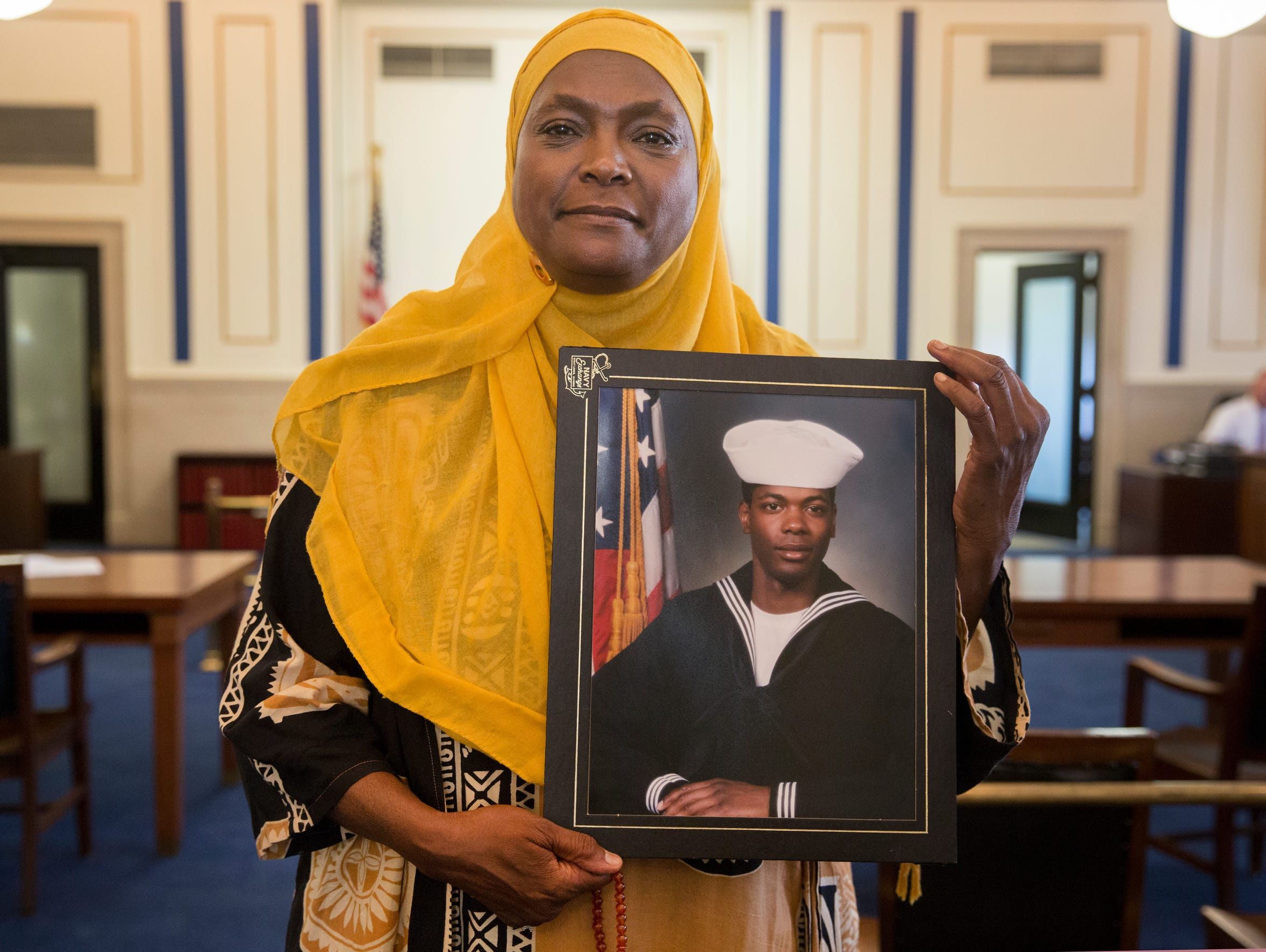 Rukiye Abdul-Mutakallim holds a photo of her son, Suliman Ahmed Abdul-Mutakallim. He's a Navy veteran and served in the Iraq War.