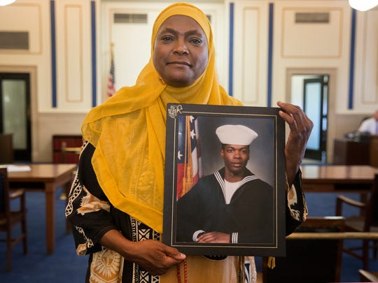 Rukiye Abdul-Mutakallim, holds a photo of her son, Suliman Abdul-Mutakallim. He spent three years in the Navy. Rukiye attended a competency hearing Tuesday, Sept. 26, 2017 for Javon Coulter in Hamilton County Common Pleas Judge Megan Shanahan's courtroom. Coulter, 16, is charged as an adult with aggravated robbery and aggravated murder in the shooting death of 39-year-old Suliman Abdul-Mutakallim. The shooting happened in South Cumminsville on June 28, 2015. Coulter was declared competent.