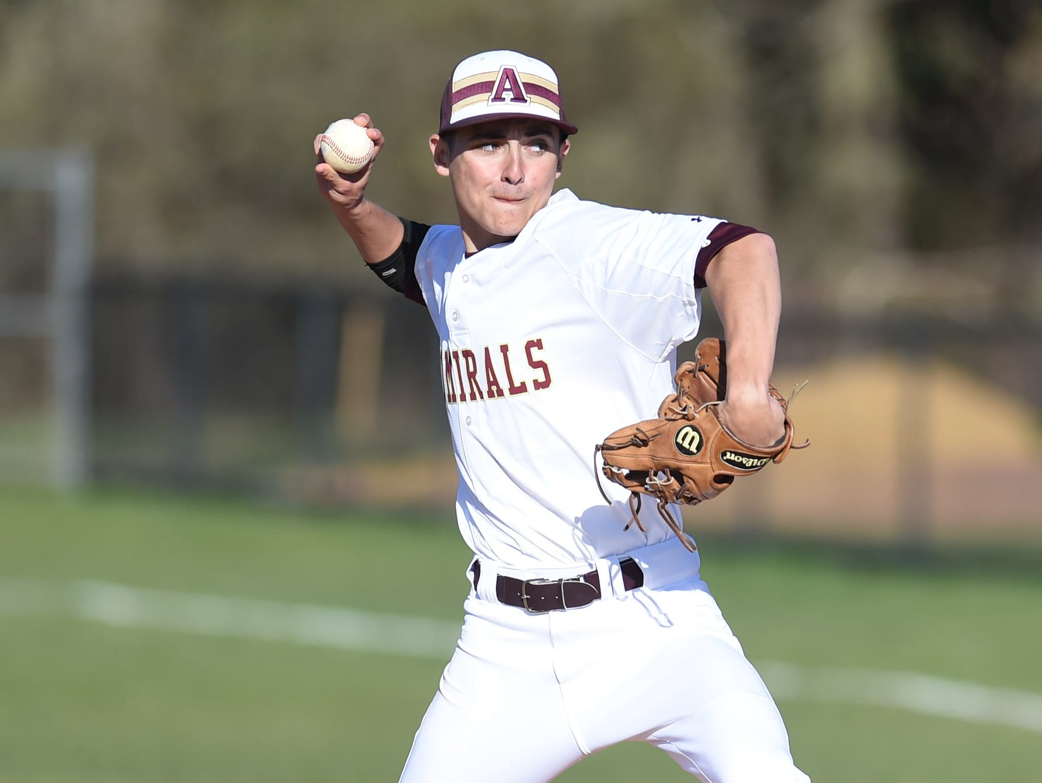 Arlington's Andrew Kemmerer pitches during Tuesday's home game versus John Jay.