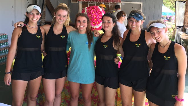 From left: Lizzie Nowak,  Avery Bills, Taylor Batten, Frances Taylor, Madison Mougey and Sadie Goyins celebrate clinching Pensacola Catholic's first state tournament appearance since 2013.