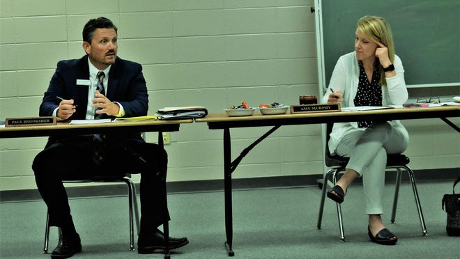 Bryan County School Superintendent Paul Brooksher, left, told board members at their monthly meeting May 28 that fall school opening details are not yet finalized and individual school budgets would likely not be cut. Board chairman Amy Murphy is on the right.