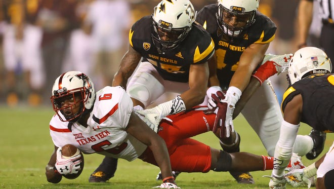 Texas Tech Red Raiders wide receiver Devin Lauderdale (6) is tackled by the Arizona State Sun Devils at Sun Devil Stadium. Mandatory Credit: Mark J. Rebilas-USA TODAY Sports