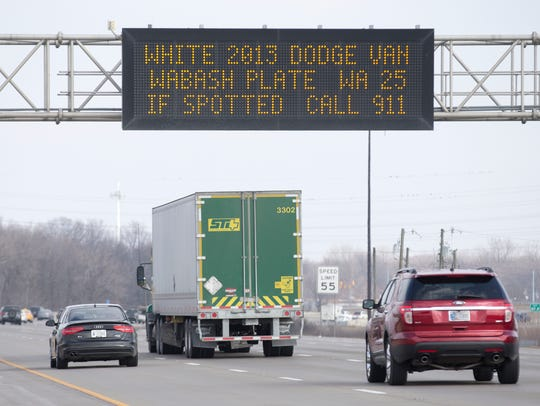 An Amber Alert-style highway sign on Interstate 70, east of Downtown Indianapolis, asking motorists to be on the lookout for a vehicle that may be tied to the suspect in an earlier murder of an adult and a child in Zionsville, Feb. 17, 2016.
