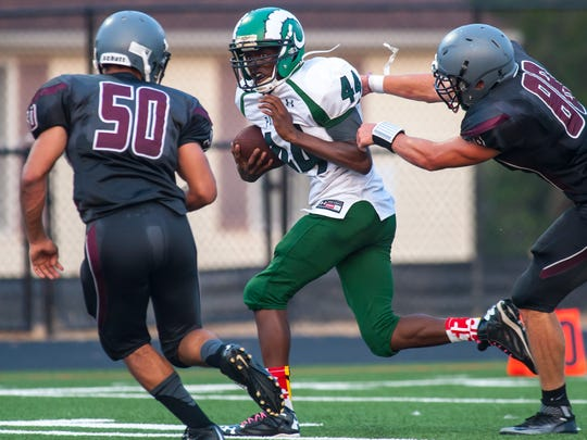 Parkside running back Nayel Oge (44) fights off a tackle from Snow Hill's Sunny Hicks (88) as Bryan Outten (50) approaches at Snow Hill on Friday evening.