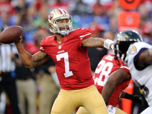San Francisco 49ers quarterback Colin Kaepernick (7) throws to a receiver as he is pressured in the first half of an NFL preseason football game against the Baltimore Ravens, Thursday, Aug. 7, 2014, in Baltimore. (AP Photo/Nick Wass)