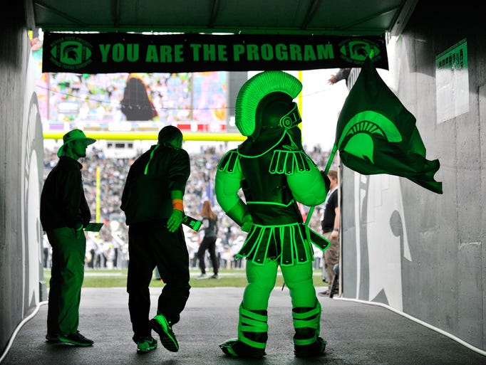Sparty about to exit the tunnel before the game. Michigan