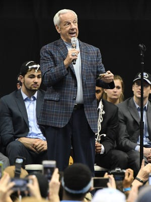 UNC coach Roy Williams speaks at a championship celebration.