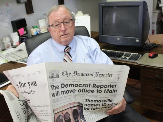 Publisher Goodloe Sutton of The Democrat-Reporter, a weekly newspaper in  Linden, Ala., reviews an article about the paper moving to a new location.